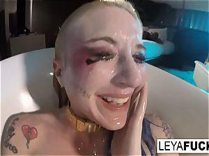 Leya Falcon uses the tub shower head on her backside