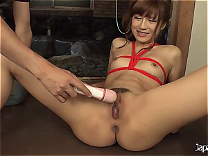 roping her up and making her unload