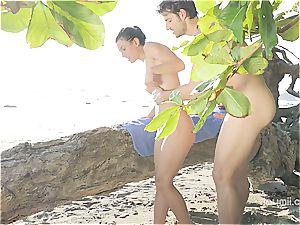 Julia Roca has some fun in the sun with her beau