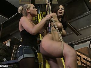 Kathia Nobili slapping the caboose of warm doll with lash