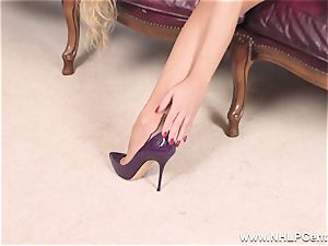 platinum-blonde strips off lingerie and solos in nylons and stilettos