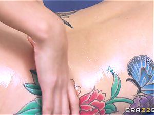 Janice Griffith give Monique Alexander a massage to reminisce