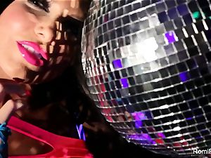 Romi plays w disco ball then inserts playthings in her vag