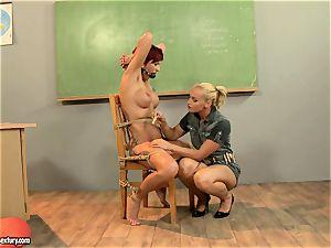 Kathia Nobili giving a mischievous lesson to a torrid crimson head