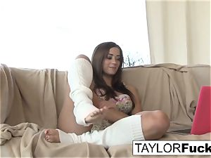 Taylor plays with her gash outdoors